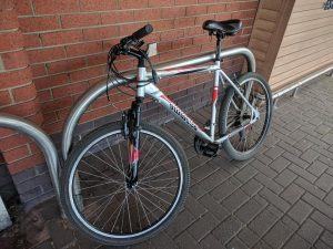 Ammaco Man's silver mountain bike with white and red name.